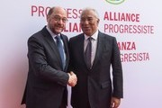 """Martin Schulz (L), the Social Democratic Party's (SPD) main candidate in upcoming German parliamentary elections, greets Portugal's Prime minister Antonio Costa guests prior to a convention of the """"Progressive Alliance"""" which brings together European social democratic party leaders at the SPD party headquarters in Berlin on March 13, 2017. / AFP PHOTO / John MACDOUGALL"""