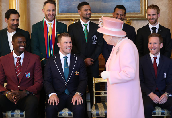 ICC Cricket World Cup Team Captains Meet Queen Elizabeth II At Buckingham Palace [photograph,event,formal wear,suit,elizabeth ii,team captains,l-r,back row,front row,buckingham palace,london,england,icc cricket world cup]