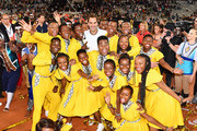 Roger Federer of Switzerland hugs the kids after the Match in Africa between Roger Federer and Rafael Nadal at Cape Town Stadium on February 07, 2020 in Cape Town, South Africa.