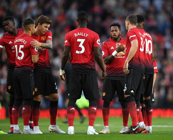 Manchester United vs. Leicester City - Premier League [player,sports,team sport,ball game,team,football player,soccer player,sport venue,sports equipment,red,fred,team mates,v,hands,manchester,united kingdom,manchester united,leicester city,premier league,match]