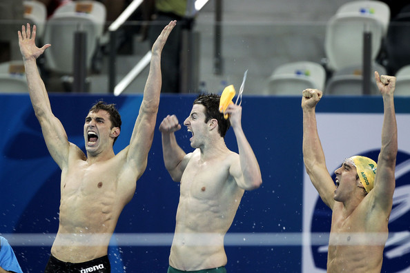 Matthew Abood (L-R) Matthew Targett, James Magnussen and Matthew Abood of Australia celebrate winning the gold medal in the Men's 4x100m Freestyle Relay during Day Nine of the 14th FINA World Championships at the Oriental Sports Center on July 24, 2011 in Shanghai, China.