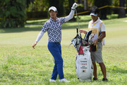 Ryo Ishikawa of Japan pulls his club out of his bag on the 13th hole during day four of the Maybank Championship Malaysia at Saujana Golf and Country Club on February 4, 2018 in Kuala Lumpur, Malaysia.