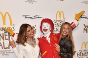 Jana Ina Zarella, Ronald McDonald and Alena Gerber during the McDonald's charity gala at Hotel Bayerischer Hof on October 21, 2016 in Munich, Germany.