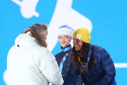 Silver medalist Charlotte Kalla of Sweden receives her flowers from President of the International Ski Federation (FIS) Gian-Franco Kasper during the medal ceremony for the WomenÂ's Skiathlon 7.5km Classic & 7.5km Free during day 1 of the Sochi 2014 Winter Olympics at Medals Plaza on February 8, 2014 in Sochi, Russia.