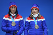 Bronze medalists Marit Bjoergen and Maiken Caspersen Falla of Norway stand on the podium during the medal ceremony for Cross-Country Skiing - Ladies' Team Sprint Free on day 13 of the PyeongChang 2018 Winter Olympic Games at Medal Plaza on February 22, 2018 in Pyeongchang-gun, South Korea.