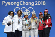 Silver medalists Lauren Gibbs and Elana Meyers Taylor of the United States, gold medalists Lisa Buckwitz and Mariama Jamanka of Germany and bronze medalists Phylicia George and Kaillie Humphries of Canada celebrate during the medal ceremony for Bobsleigh - Women on day 13 of the PyeongChang 2018 Winter Olympic Games at Medal Plaza on February 22, 2018 in Pyeongchang-gun, South Korea.