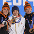 (L-R) Silver medalist Ireen Wust of the Netherlands, gold medalist Martina Sablikova of the Czech Republic and bronze medalist Carien Kleibeuker of the Netherlands celebrate on the podium during the medal ceremony for the Speed Skating Ladies' 5000m on day thirteen of the Sochi 2014 Winter Olympics at  at Medals Plaza on February 20, 2014 in Sochi, Russia.