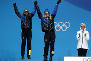 Silver medalists Charlotte Kalla and Stina Nilsson of Sweden celebrate during the medal ceremony for Cross-Country Skiing - Ladies' Team Sprint Free on day 13 of the PyeongChang 2018 Winter Olympic Games at Medal Plaza on February 22, 2018 in Pyeongchang-gun, South Korea.