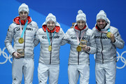 Gold medalists Vinzenz Geiger, Fabian Riessle, Eric Frenzel and Johannes Rydzek of Germany celebrate during the medal ceremony for Nordic Combined - Team Gundersen LH/4x5km Cross-Country on day 14 of the PyeongChang 2018 Winter Olympic Games at Medal Plaza on February 23, 2018 in Pyeongchang-gun, South Korea.