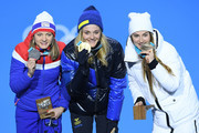 (L-R) Silver medalist Maiken Caspersen Falla of Norway, gold medalist Stina Nilsson of Sweden and bronze medalist Yulia Belorukova of Olympic Athlete from Russia pose during the medal ceremony for the Cross-Country Ladies' Sprint Classic on day five of the PyeongChang 2018 Winter Olympics at Medal Plaza on February 14, 2018 in Pyeongchang-gun, South Korea.