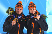 Bronze medalist Michel Mulder of the Netherlands and gold medalist Stefan Groothuis of the Netherlands celebrate during the medal ceremony for the Speed Skating Men's 1000m on day six of the Sochi 2014 Winter Olympics at Medals Plaza on February 13, 2014 in Sochi, Russia.