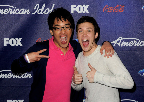 Singers Heejun Han (L) and Phillip Phillips arrive at Fox's American Idol finalist party at The Grove on March 1, 2012 in Los Angeles, California.