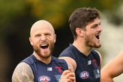 Nathan Jones and Angus Brayshaw of the Demons have a laugh during a goal kicking competition during a Melbourne Demons AFL training session at Gosch's Paddock on May 15, 2018 in Melbourne, Australia.