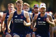 Tom McDonald and  Nathan Jones of the Demons run during a Melbourne Demons AFL pre-season training session at Gosch's Paddock on December 18, 2015 in Melbourne, Australia.