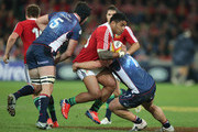 Manu Tuilagi of the Lions is tackled by Nic Henderson during the International Tour Match between the Melbourne Rebels and the British & Irish Lions at AAMI Park on June 25, 2013 in Melbourne, Australia.
