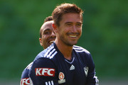 Harry Kewell of the Victory laughs with teammate Archie Thompson during a Melbourne Victory A-League training session at Olympic Park on September 14, 2011 in Melbourne, Australia.