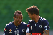 Harry Kewell of the Victory laughs with teammate Archie Thompson during a Melbourne Victory A-League training session at AAMI Park on September 14, 2011 in Melbourne, Australia.