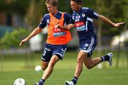 Adrian Leijer of the Victory competes with Harry Kewell during a Melbourne Victory A-League training session at Gosch's Paddock on October 20, 2011 in Melbourne, Australia.