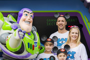 In this handout photo provided by Disney Parks, actress Melissa Joan Hart and husband singer-songwriter Mark Wilkerson (R), along with their sons Mason, Tucker, and Braydon pose with Buzz Lightyear at Magic Kingdom park on September 18, 2015 in Lake Buena Vista, Florida. The family celebrated Tucker's third birthday at Walt Disney World Resort.