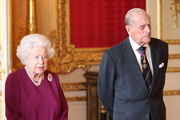 Queen Elizabeth II and Prince Philip, Duke of Edinburgh join members of the Order of Merit ahead of a luncheon at Windsor Castle on May 7, 2019 in Windosr, England. Established in 1902 by King Edward VII, The Order of Merit recognises distinguished service in the armed forces, science, art, literature, or for the promotion of culture. Admission into the order remains the personal gift of The Queen and is restricted to a maximum of 24 living recipients from the Commonwealth realms, plus a limited number of honorary members.