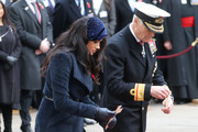 Meghan, Duchess of Sussex plants a cross carrying a personal message in memory of those who lost their lives in the service of others as she attends the 91st Field of Remembrance at Westminster Abbey on November 07, 2019 in London, England.