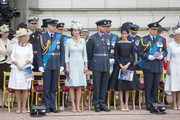 (L-R) Camilla, Duchess of Cornwall, Prince William, Duke of Cambridge, Catherine, Duchess of Cambridge, Prince Harry, Duke of Sussex, Meghan, Duchess of Sussex and Prince Andrew, Duke of York during the RAF 100 ceremony at Buckingham Palace, as members of the Royal Family attend events to mark the centenary of the RAF on July 10, 2018 in London, England.