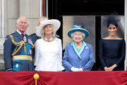 (L-R)  Prince Charles, Prince of Wales, Prince Andrew, Duke of York, Camilla, Duchess of Cornwall, Queen Elizabeth II and Meghan, Duchess of Sussex watch the RAF flypast on the balcony of Buckingham Palace, as members of the Royal Family attend events to mark the centenary of the RAF on July 10, 2018 in London, England.