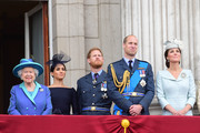 Queen Elizabeth II, Meghan, Duchess of Sussex, Prince Harry, Duke of Sussex, Prince William Duke of Cambridge and Catherine, Duchess of Cambridge watch the RAF 100th anniversary flypast from the balcony of Buckingham Palace on July 10, 2018 in London, England.