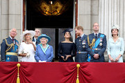 (L-R)  Prince Charles, Prince of Wales, Camilla, Duchess of Cornwall, Prince Andrew, Duke of York, Queen Elizabeth II, Meghan, Duchess of Sussex, Prince Harry, Duke of Sussex, Prince William, Duke of Cambridge and Catherine, Duchess of Cambridge watch the RAF flypast on the balcony of Buckingham Palace, as members of the Royal Family attend events to mark the centenary of the RAF on July 10, 2018 in London, England.