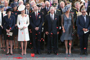 Prime Minister Theresa May (left), the Duke and Duchess of Cambridge King Philippe (third right) and Queen Mathilde (second right) watch as the poppies fall from the roof of the Menin Gate on July 30th, 2017 in Ypres, Belgium.