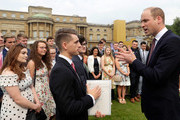 Prince William, Duke of Cambridge meets British gymnast Max Whitlock during a day of DofE presentations at Buckingham Palace on May 24, 2018 in London, England. Over 3,000 young people from across the UK received the Gold Duke of Edinburgh Awards at a day of presentations in Buckingham Palace gardens.