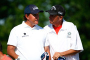 Phil Mickelson (L) and his caddie Jim MacKay look over a shot on the first hole during the final round of the Memorial Tournament presented by Nationwide Insurance at Muirfield Village Golf Club on June 1, 2014 in Dublin, Ohio.