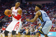 Dwight Howard #12 of the Houston Rockets looks to drive with the basketball against Alex Stepheson #35 of the Memphis Grizzlies during their game at the Toyota Center on March 14, 2016 in Houston, Texas.