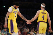 Anthony Davis #3 and Alex Caruso #4 of the Los Angeles Lakers react during the fourth quarter in a game against the Memphis Grizzlies at Staples Center on February 21, 2020 in Los Angeles, California. NOTE TO USER: User expressly acknowledges and agrees that, by downloading and or using this Photograph, user is consenting to the terms and conditions of the Getty Images License Agreement.