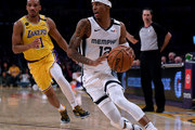 Ja Morant #12 of the Memphis Grizzlies drives to the basket past Avery Bradley #11 of the Los Angeles Lakers during the third quarter at Staples Center on February 21, 2020 in Los Angeles, California.  NOTE TO USER: User expressly acknowledges and agrees that, by downloading and or using this photograph, User is consenting to the terms and conditions of the Getty Images License Agreement.