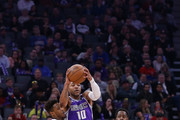 Frank Mason III #10 of the Sacramento Kings is fouled by Mario Chalmers #6 of the Memphis Grizzlies while taking a half court shot before the half time buzzer at Golden 1 Center on December 31, 2017 in Sacramento, California. NOTE TO USER: User expressly acknowledges and agrees that, by downloading and or using this photograph, User is consenting to the terms and conditions of the Getty Images License Agreement.