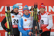Gold medallist Maxim Vylegzhanin (C) of Russia poses with silver medallist Dario Cologna (L) of Switzerland and bronze medallist Alex Harvey of Canada after the Men's 30km Cross-Country Skiathlon during the FIS Nordic World Ski Championships at the Lugnet venue on February 21, 2015 in Falun, Sweden.