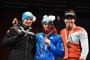 Gold medallist Maxim Vylegzhanin (C) of Russia poses with silver medallist Dario Cologna (L) of Switzerland and bronze medallist Alex Harvey of Canada during the medal ceremony for the Men's 30km Cross-Country Skiathlon during the FIS Nordic World Ski Championships at the Lugnet venue on February 21, 2015 in Falun, Sweden.
