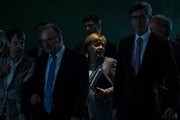 """German Chancellor Angela Merkel (3rd R) and (L-R) Stuttgart's mayor Fritz Kuhn, German Environment Minister Barbara Hendricks, Saxony-Anhalt's State Premier Reiner Haseloff, Munich's mayor Dieter Reiter and Aachen's mayor Marcel Philipp arrive for a press conference after the so-called """"Diesel Summit"""" with mayors of large German cities in the chancellery in Berlin on November 28, 2017, in order to look at ways of improving air quality. / AFP PHOTO / John MACDOUGALL"""