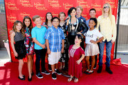 (L-R) Actors Joelle Better, Emmy Perry, Jake Brennan, Izzy Eggerling, Jacob Guenther, Caitlin Carmichael, Briana Renee, Joey Luthman, Laya Hayes, Aedin Mincks, and musician Will Ovid pose with the Demi Lovato Wax Figure (C) during Merlin's Magic Wand Children's Charity and Madame Tussauds Hollywood welcome children for a magical day out at Madame Tussauds on September 26, 2015 in Hollywood, California.