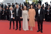 "(L-R) Claire Denis, director Hong SangSoo, Isabelle Hupert, Kim Minheet  and Jeong Jinyoung of  'Claire's Camera (Keul-Le-Eo-Ui-Ka-Me-La)' walk the red carpet ahead of the ""The Meyerowitz Stories"" screening during the 70th annual Cannes Film Festival at Palais des Festivals on May 21, 2017 in Cannes, France."