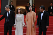 """(L-R) Director Hong SangSoo, Isabelle Hupert, Kim Minheet  and Jeong Jinyoung of  'Claire's Camera (Keul-Le-Eo-Ui-Ka-Me-La)' walk the red carpet ahead of the """"The Meyerowitz Stories"""" screening during the 70th annual Cannes Film Festival at Palais des Festivals on May 21, 2017 in Cannes, France."""