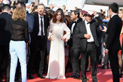 """Isabelle Hupert and director Hong SangSoo of  'Claire's Camera (Keul-Le-Eo-Ui-Ka-Me-La)' walk the red carpet ahead of the """"The Meyerowitz Stories"""" screening during the 70th annual Cannes Film Festival at Palais des Festivals on May 21, 2017 in Cannes, France."""