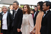 """(2nd L-R) Director Hong SangSoo, Isabelle Hupert, Kim Minheet  and Jeong Jinyoung of  'Claire's Camera (Keul-Le-Eo-Ui-Ka-Me-La)' walk the red carpet ahead of the """"The Meyerowitz Stories"""" screening during the 70th annual Cannes Film Festival at Palais des Festivals on May 21, 2017 in Cannes, France."""