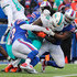 Jordan Poyer Photos - MarQueis Gray #48 of the Miami Dolphins runs the ball as Lorenzo Alexander #57 of the Buffalo Bills, Jordan Poyer #21 of the Buffalo Bills and Ramon Humber #50 of the Buffalo Bills tackle him during the third quarter on December 17, 2017 at New Era Field in Orchard Park, New York. - Miami Dolphins vBuffalo Bills