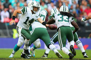 Ryan Fitzpatrick #14 of the New York Jets hands off to Chris Ivory #33 of the New York Jets during the game against Miami Dolphins at Wembley Stadium on October 4, 2015 in London, England.