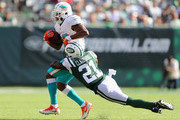 Defensive back Morris Claiborne #21 of the New York Jets tackles running back Kenyan Drake #32 of the Miami Dolphins during the second half at MetLife Stadium on September 16, 2018 in East Rutherford, New Jersey.  The Miami Dolphins won 20-12.