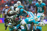 Chris Ivory #33 of the New York Jets is tackled by the Miami Dolphins defense during the game at Wembley Stadium on October 4, 2015 in London, England.