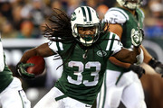 Chris Ivory #33 of the New York Jets runs the ball in the first half against the Miami Dolphins during their game at MetLife Stadium on December 1, 2014 in East Rutherford, New Jersey.