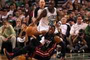 Dwyane Wade #3 of the Miami Heat attempts to control his dribble as he falls to the court against Mickael Pietrus #28 of the Boston Celtics in Game Four of the Eastern Conference Finals in the 2012 NBA Playoffs on June 3, 2012 at TD Garden in Boston, Massachusetts. NOTE TO USER: User expressly acknowledges and agrees that, by downloading and or using this photograph, User is consenting to the terms and conditions of the Getty Images License Agreement.